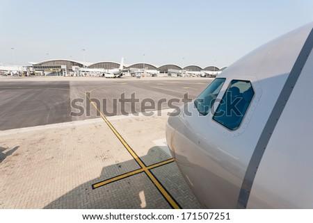 Passenger aircraft on the runway of Hong Kong International Airport site. - stock photo