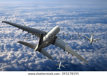 Passenger airliner above the clouds - stock photo