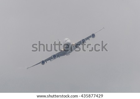 Passenger airliner flying in bad weather - stock photo