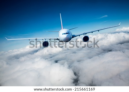 Passenger Airliner flying in the clouds