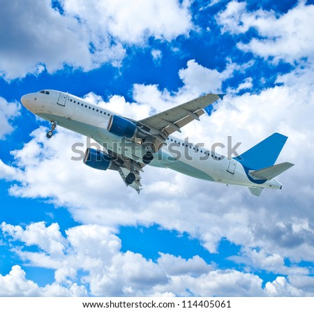 Passenger airplane against blue sky