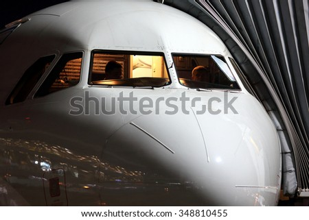 Passenger airplane cockpit in night. - stock photo