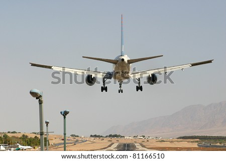 Passenger airplane few moments before landing. - stock photo