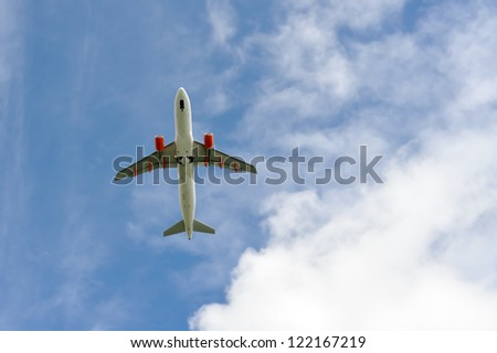 Passenger airplane few moments before landing to airport