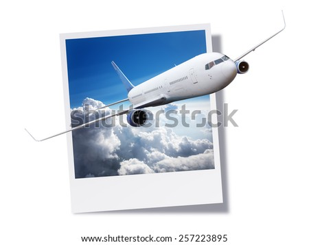 Passenger airplane flying above clouds breaking free from an instant print photo or postcard concept for travel and vacations - stock photo