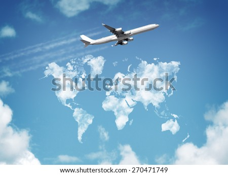 Passenger airplane flying above sky with clouds in shape of world map concept for travel and vacations - stock photo