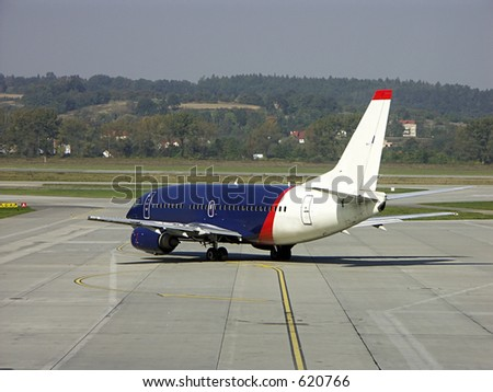 Passenger airplane getting ready for flight - stock photo