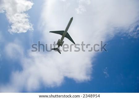 Passenger airplane in flight - stock photo