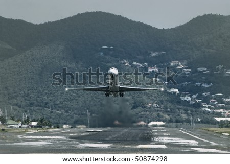 Passenger airplane landing on a small local airport - stock photo