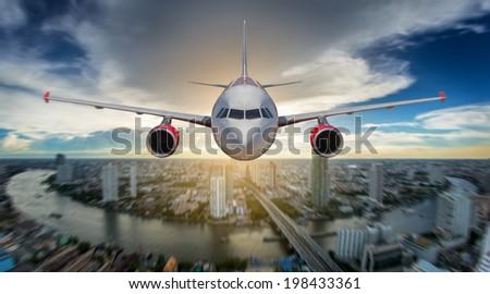 Passenger airplane landing on runway in airport. ovey bangkok sky - stock photo