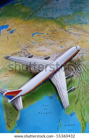 Passenger Airplane on Top of Map - stock photo