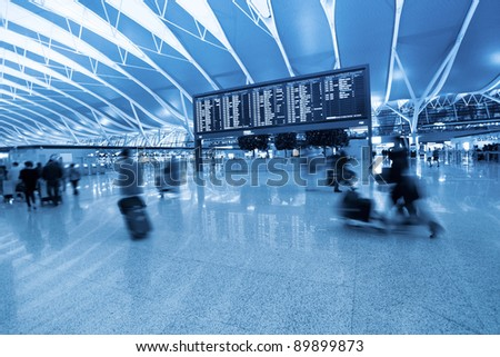 passenger and flight information board in shanghai pudong international airport - stock photo
