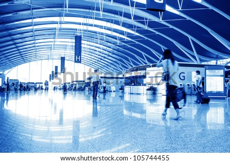 passenger at the airport, motion blur - stock photo