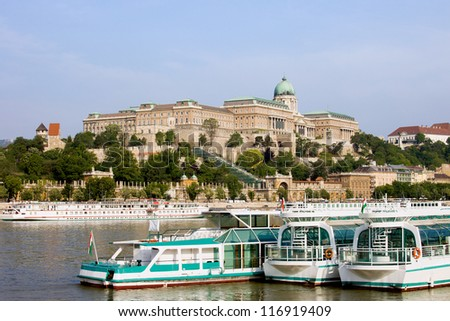 Passenger boats on the Danube River and Buda Castle in Budapest, Hungary. - stock photo