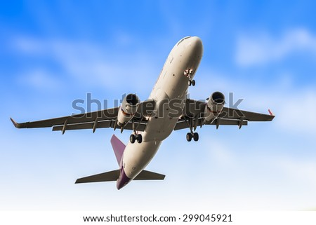 Passenger business airplane take off and flying in blue sky, use for air transport, journey and travel concept - stock photo