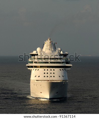 Passenger cruise ship at sea front view - stock photo