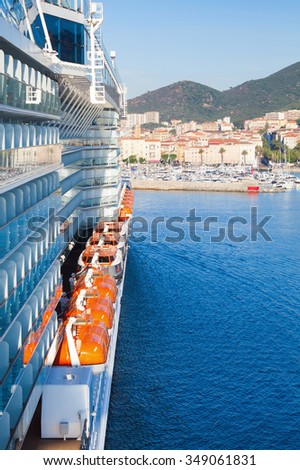 Passenger cruise ship enters the port of Ajaccio, Corsica island, France. View from a captain bridge wing - stock photo