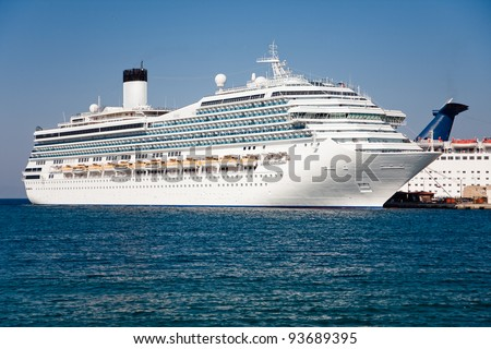 Passenger cruise ship. Large white passenger ship waiting in Rhodes Island port