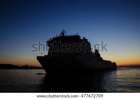 PASSENGER FERRY AT DAWN IN GDYNIA. Passenger ferry entering the port of Gdynia