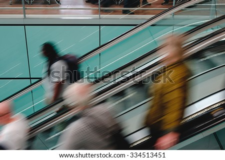 Passenger in the airport London, blurred motion. - stock photo
