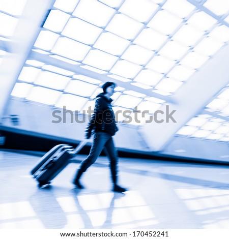 Passenger in the Beijing airport,motion blur - stock photo