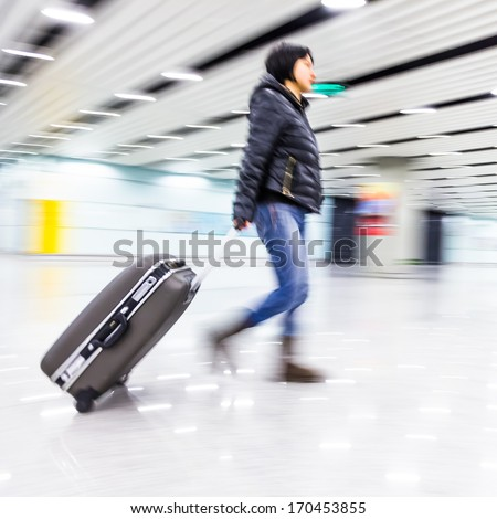 Passenger in the Beijing airport,motion blur