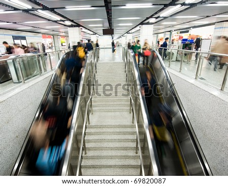 passenger in the subway station in shanghai china, blurred motion. - stock photo
