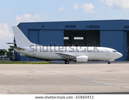 Passenger jet airplane in unmarked white color - stock photo