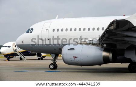 passenger jet at airport - stock photo