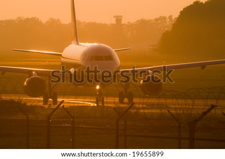 passenger jet at sunset