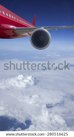 Passenger Jet Plane Flying Above the clouds for travel concept - stock photo