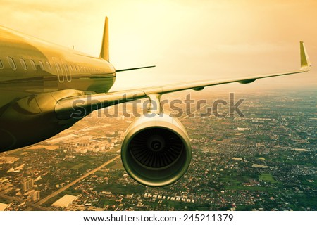 passenger jet plane flying  above urban scene  use for aircraft transportation and traveling business background - stock photo