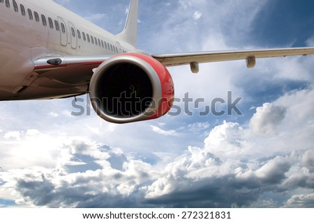 Passenger Jet Plane Flying in the clouds for travel concept - stock photo