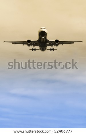 passenger jet taking off or descending through color gradient clouds