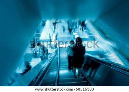 passenger on moving escalator in Guangzhou subway station - stock photo