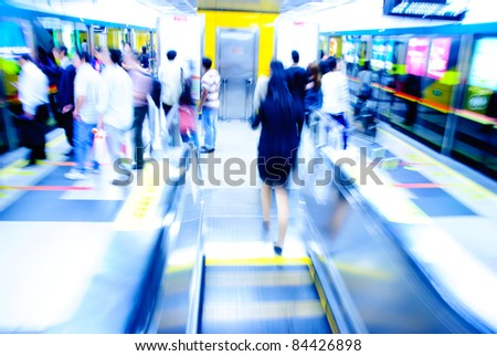 passenger on moving escalator in Guangzhou subway station - stock photo