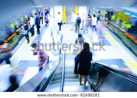 passenger on moving escalator in Guangzhou subway station blur motion - stock photo