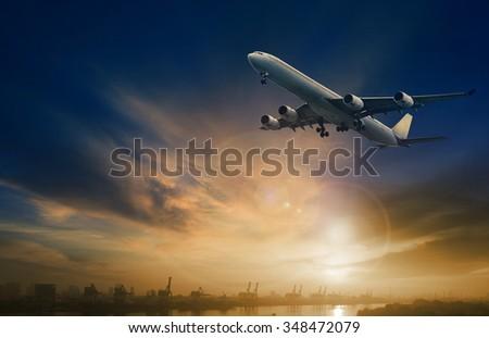 passenger plane flying on beautiful  dusky sky  - stock photo