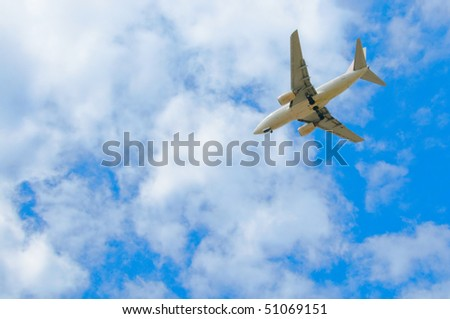 Passenger plane in the blue sky with clouds - stock photo