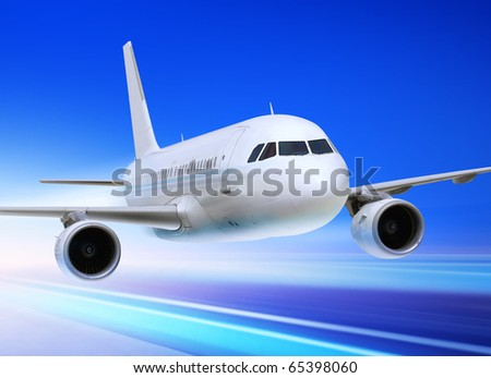 passenger plane is accelerated from an airport runway - stock photo