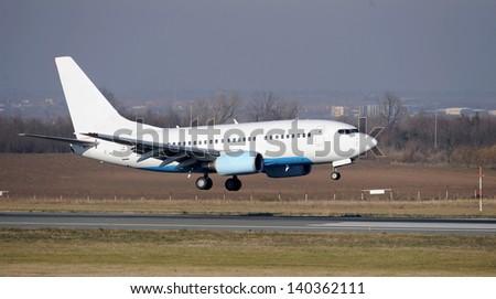 Passenger plane landing - stock photo