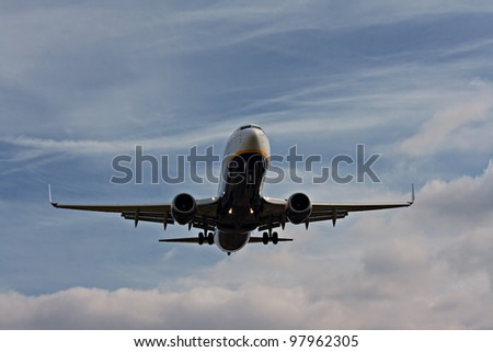 Passenger plane on final approach - stock photo