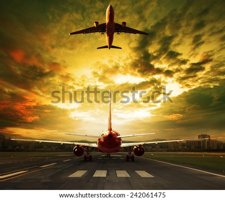passenger plane ready to take off on airport runways with urban office building background iuse for traveling ,cargo ,air transport ,business  - stock photo