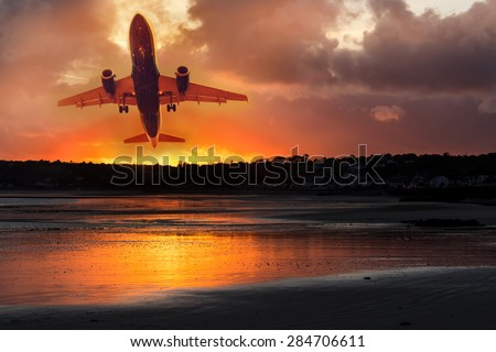 passenger plane take-off from airport at sunset - stock photo