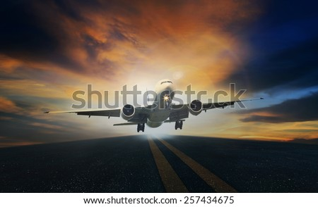 passenger plane take off from airport runways against beautiful dusky sky use for air transport  and traveling background - stock photo