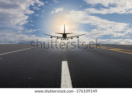 Passenger plane take off from runways with cloud sky - stock photo