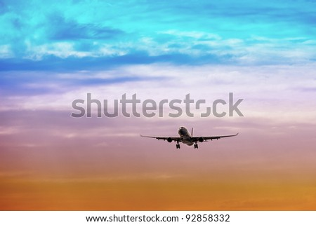 Passenger plane takes off at sunset - stock photo