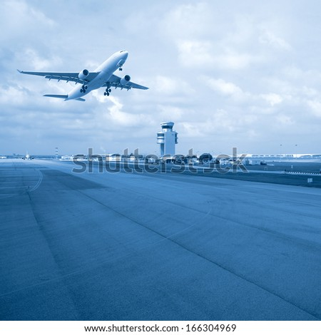 passenger plane taking off from the airport - stock photo