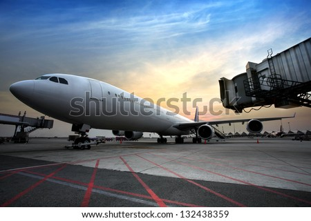 Passenger planes at the airport in the evening - stock photo