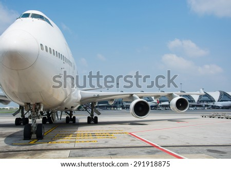 Passenger planes at the airport shoot on the bus - stock photo